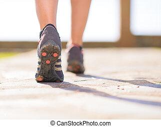 Close-up Of Female Legs Jogging