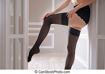 Close up of female legs wearing lace stockings