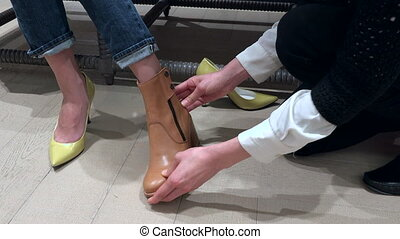 Close Up Of Female Shoes And Feet in Luxury Shop