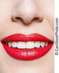 Close up of female smiling red lips