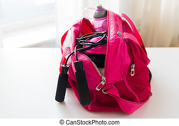 close up of female sports stuff in bag - sport, fitness,...