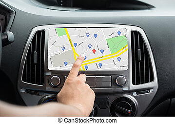 Female's Hand Using GPS Navigation
