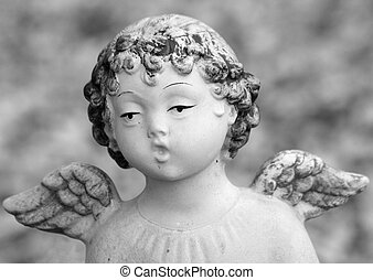 close up of figurine of singing little  winged angel