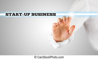 Finger Highlighting Startup Business Words - Close Up of...