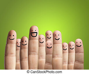 Close-up Of Fingers With Smiley Face Isolated On Green...