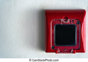 Close up of fire alarm switch in red box on wall