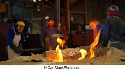 Close-up of fire flaming from furnace in foundry workshop 4k...