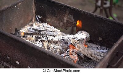 Close up of fire on chargrill. Dry sticks smoulder. Concept ...