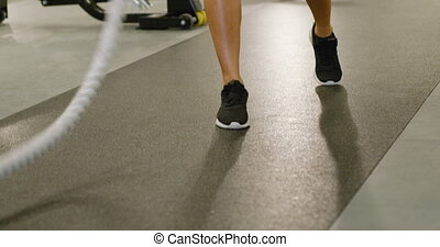Close-up of fit female high-intensity interval training...