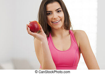 Close up of fitness woman with apple