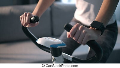 Close up of fitness woman with smart watch doing cardio