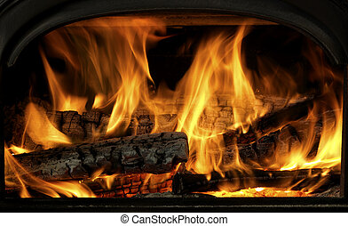 Close Up Of Flaming Logs On Fire