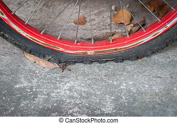 Close up of flat bicycle tire old and rust