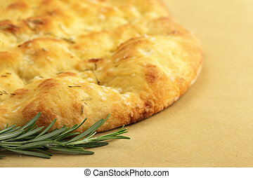 close up of flatbread and sprig of rosemary