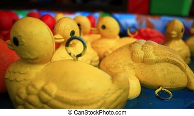 Close  up of floating yellow rubber duckies. HD. 1920x1080