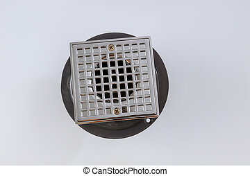 Close-up of floor drain sewer cover in bathroom isolated on white background