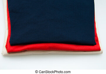 Close up of folded cotton T Shirts