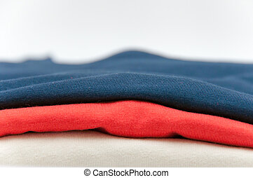 Close up of folded T Shirts
