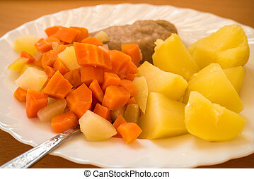 Dinner meal, braised carrot, boiled potatoes and meat