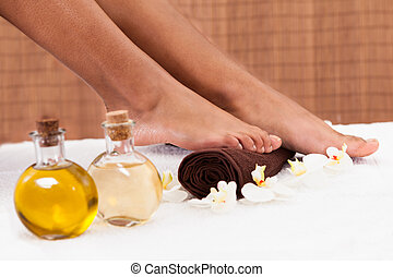 Close-up Of Foot Getting Spa Treatment