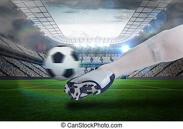 Close up of football player kicking ball - Composite image...