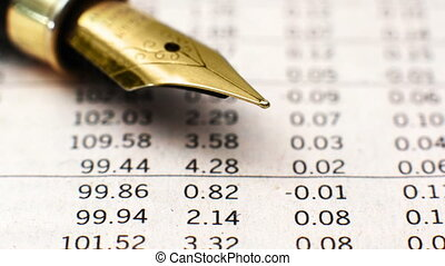 Close up of fountain pen on financial report