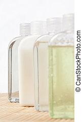 Close up of four massage oil bottles