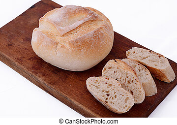 Close up of fresh bread with bread slices