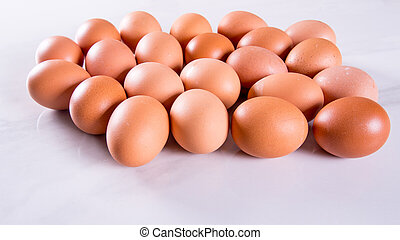 Close-up of fresh brown eggs ,side view,copy space,background,