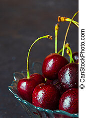 Close up of fresh cherry berries with water drops.