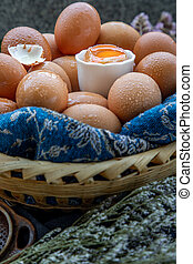 Close-up of Fresh chicken eggs on basket. Nutrition concept.