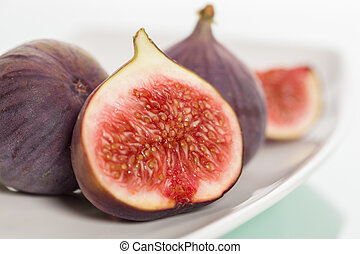 Close up of fresh figs on plate.