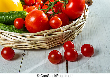 Close-up of fresh tomatoes and vegetables in a basket
