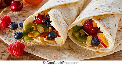 Close up of fresh tropical fruit wraps filled with whipped...