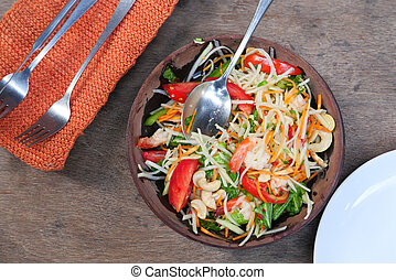 Close up of fresh vegetable salad in a bowl on table.