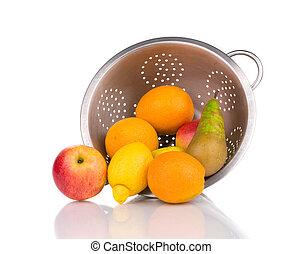 Close up of fruits in colander.