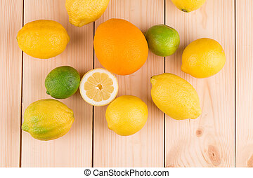 Close up of fruits on wood table.
