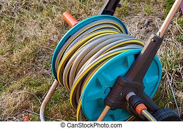 Close-up of garden hose reel for irrigation