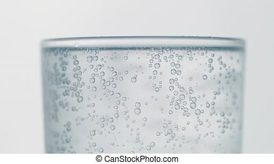 close-up of gas bubbles in the water outside the glass condensate