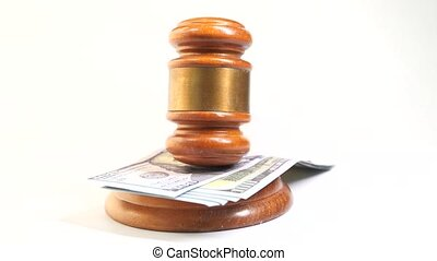 close up of gavel and cash on white background .