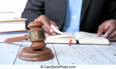 close up of gavel and stack of book on table ,