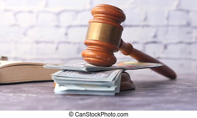 close up of gavel, cash and book on black background .