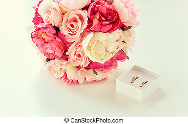 close up of gay wedding rings and flower bunch