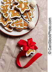 Close-up of gingerbread cookies on the plate with gift