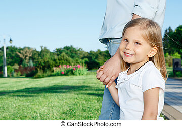 Close-up of girl holding her mother