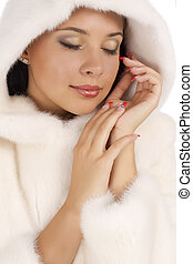 Close up of girl in a white coat