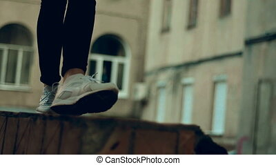 close up of girl in sneakers walks in the street