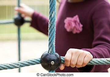Close-up of girl on a playground