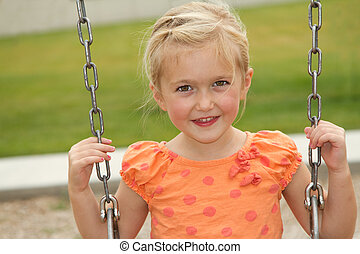 close-up of girl on swing