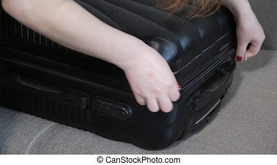 close up of girl opens suitcase, 4k